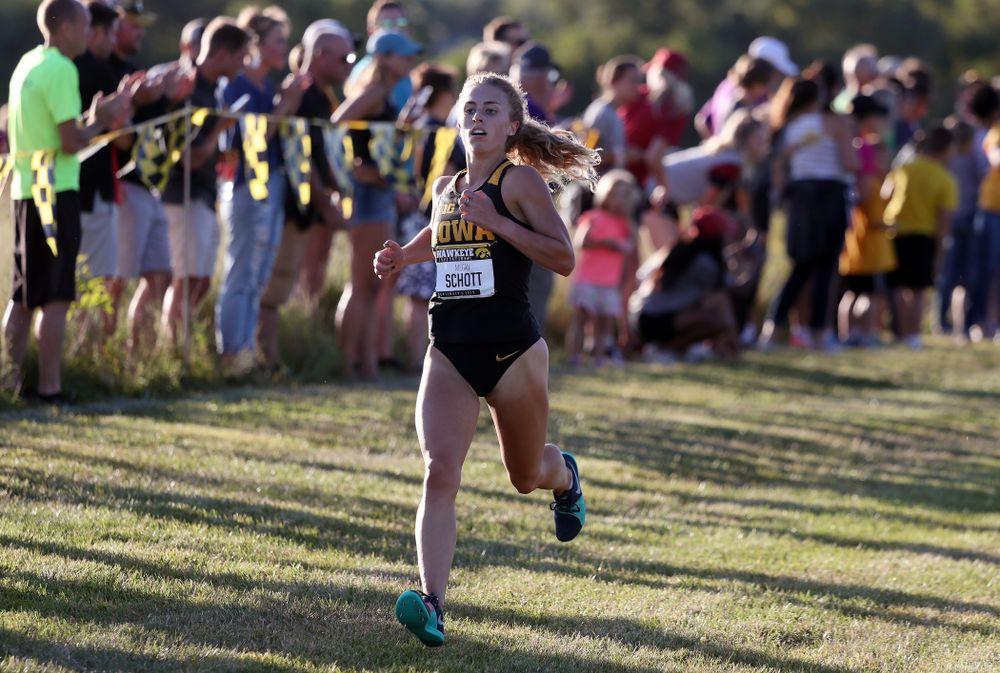 IowaÕs Megan Schott runs to the finish of the 2019 Hawkeye Invitational Friday, September 6, 2019 at the Ashton Cross Country Course. (Brian Ray/hawkeyesports.com)