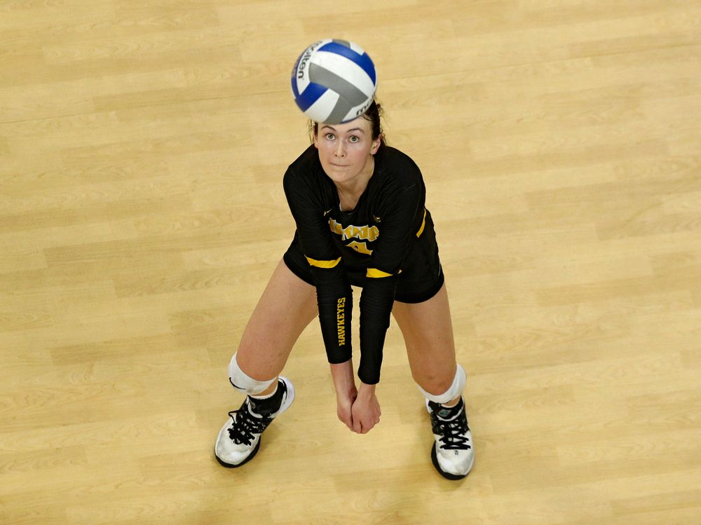 Iowa's Halle Johnston (4) eyes the ball during the fourth set of their match at Carver-Hawkeye Arena in Iowa City on Friday, Nov 29, 2019. (Stephen Mally/hawkeyesports.com)