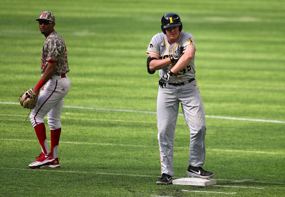 Iowa Hawkeyes first baseman Peyton Williams (45) celebrates after hitting a double during the fifth inning of their CambriaCollegeClassic game at U.S. Bank Stadium in Minneapolis, Minn. on Friday, February 28, 2020. (Stephen Mally/hawkeyesports.com)