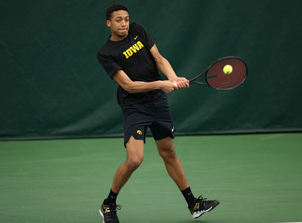 Iowa's Oliver Okonkwo returns a shot during his doubles match at the Hawkeye Tennis and Recreation Complex in Iowa City on Friday, March 6, 2020. (Stephen Mally/hawkeyesports.com)