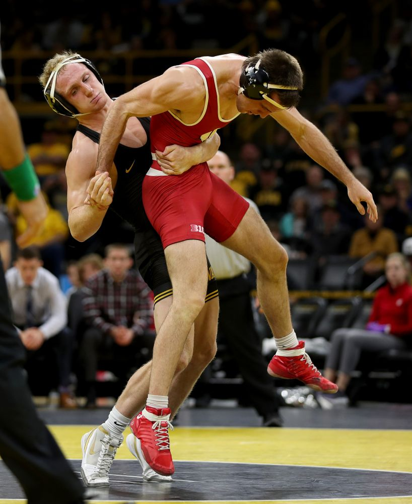IowaÕs Kaleb Young wrestles WisconsinÕs Garrett Model at 157 pounds Sunday, December 1, 2019 at Carver-Hawkeye Arena. Young won the match 12-6. (Brian Ray/hawkeyesports.com)
