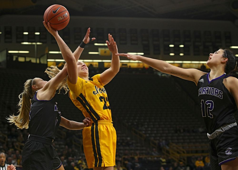 Iowa guard Kathleen Doyle (22) shoots between two defenders during the third quarter of their game against Winona State at Carver-Hawkeye Arena in Iowa City on Sunday, Nov 3, 2019. (Stephen Mally/hawkeyesports.com)