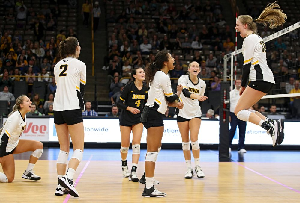 Iowa's Maddie Slagle (15), Courtney Buzzerio (2), Halle Johnston (4), Brie Orr (7), Kyndra Hansen (8), and Hannah Clayton (18) celebrate a score during the fourth set of their volleyball match at Carver-Hawkeye Arena in Iowa City on Sunday, Oct 13, 2019. (Stephen Mally/hawkeyesports.com)