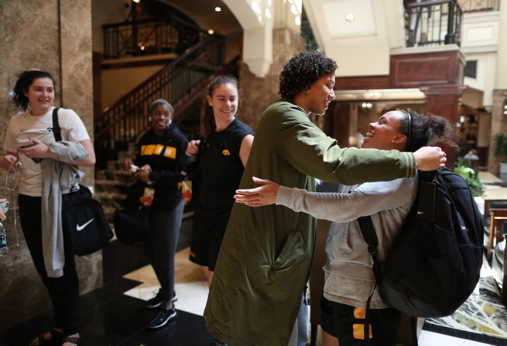 Former Hawkeye Chase Coley hugs the players following shoot around before their regional final against the Baylor Lady Bears in the 2019 NCAA Women's College Basketball Tournament Monday, April 1, 2019 at Greensboro Coliseum in Greensboro, NC.(Brian Ray/hawkeyesports.com)