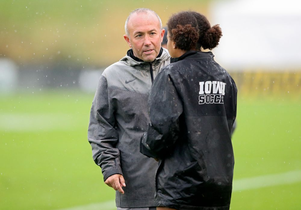 Iowa head coach Dave DiIanni talks with midfielder/forward Melina Hegelheimer (26) during the second half of their match at the Iowa Soccer Complex in Iowa City on Sunday, Sep 29, 2019. (Stephen Mally/hawkeyesports.com)