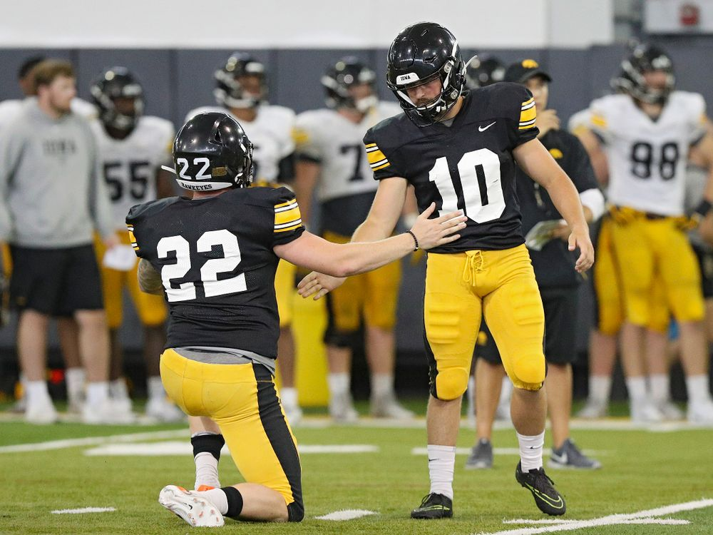 Iowa Hawkeyes' Michael Sleep-Dalton (22) slaps hands with place kicker Caleb Shudak (10) after a field goal during Fall Camp Practice No. 6 at the Hansen Football Performance Center in Iowa City on Thursday, Aug 8, 2019. (Stephen Mally/hawkeyesports.com)
