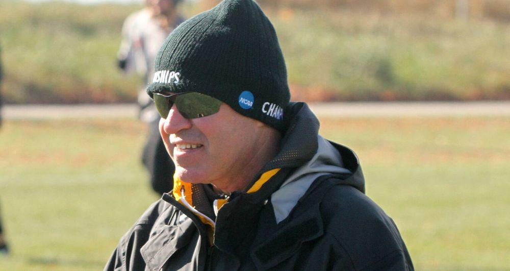 Head coach Randy Hasenbank watches his team warm up before the NCAA Regional in Ames, Iowa.