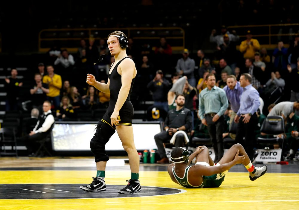 Iowa's Spencer Lee pins Michigan State's Rayvon Foley at 125 pounds.