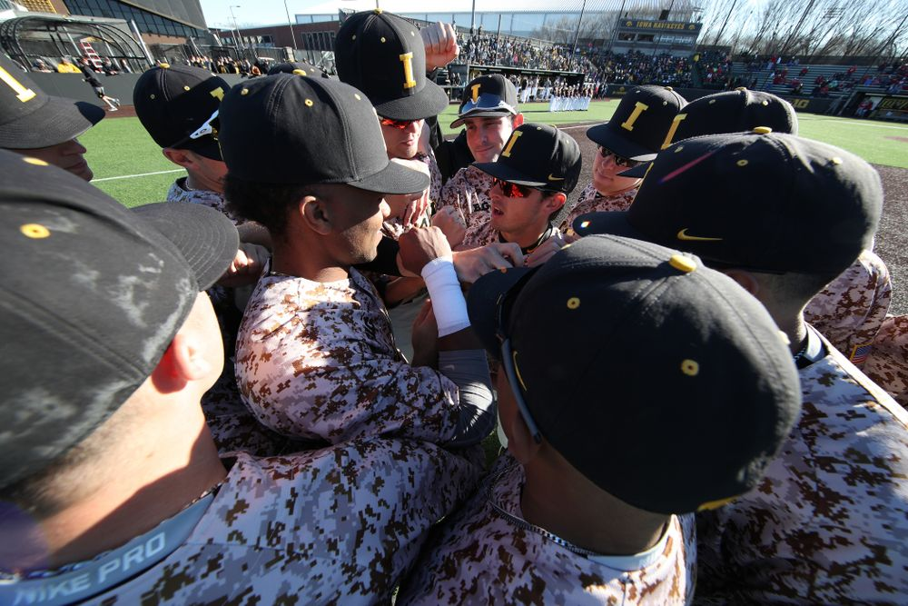 The Iowa Hawkeyes gather before their game against the Nebraska Cornhuskers on Military Appreciation Night Friday, April 19, 2019 at Duane Banks Field. (Brian Ray/hawkeyesports.com)