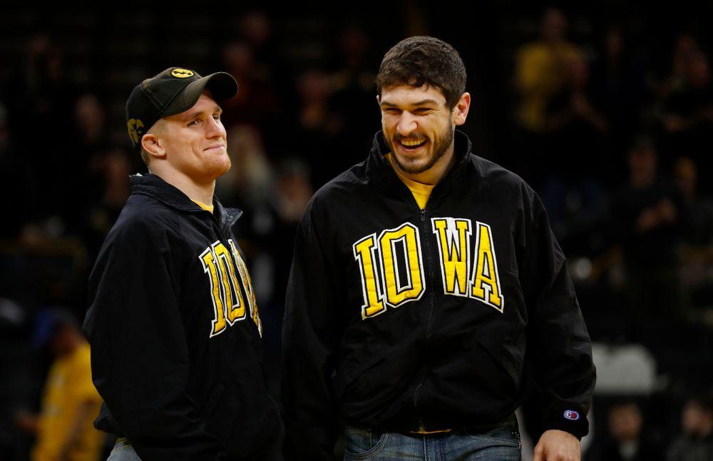 Iowa seniors Phillip Laux and Logan McQuillen following their meet against Northwestern