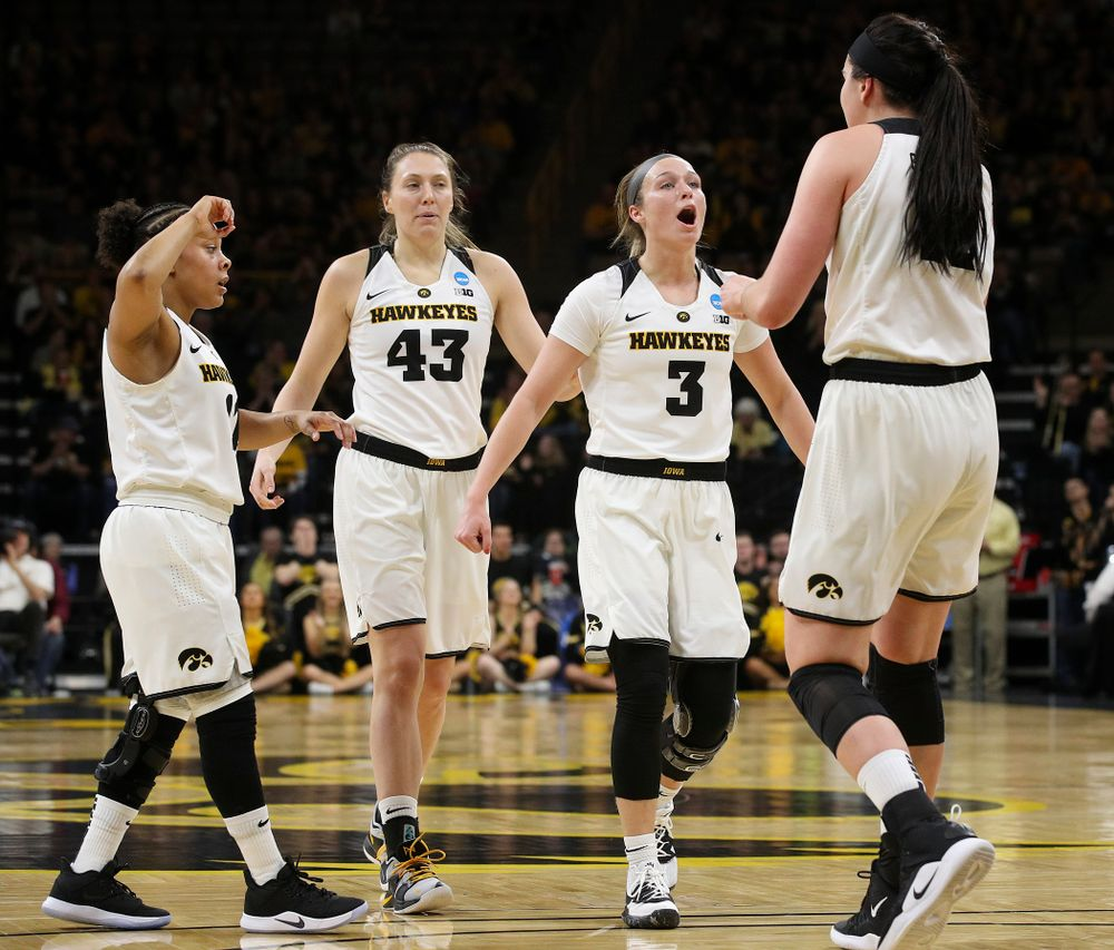 Iowa Hawkeyes guard Tania Davis (11), forward Amanda Ollinger (43), guard Makenzie Meyer (3), and forward Megan Gustafson (10) during the first round of the 2019 NCAA Women's Basketball Tournament at Carver Hawkeye Arena in Iowa City on Friday, Mar. 22, 2019. (Stephen Mally for hawkeyesports.com)