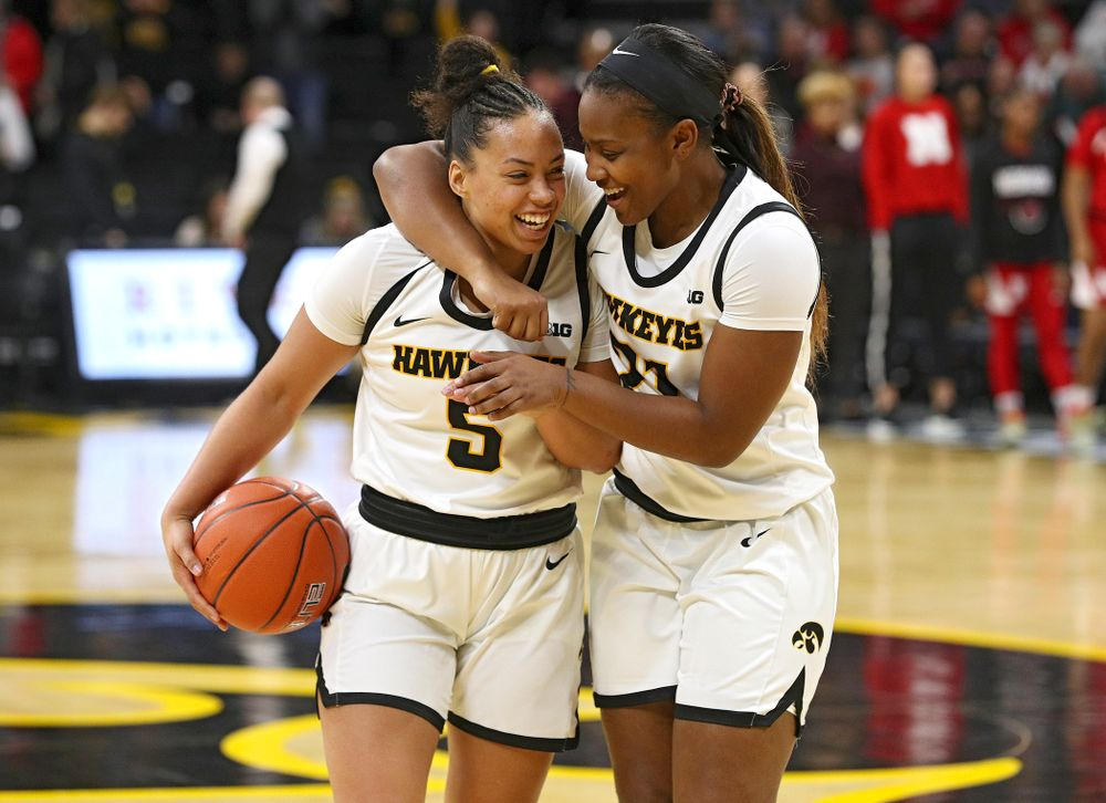 Iowa Hawkeyes guard Alexis Sevillian (5) celebrates with guard Zion Sanders (21) after winning their game at Carver-Hawkeye Arena in Iowa City on Thursday, February 6, 2020. (Stephen Mally/hawkeyesports.com)