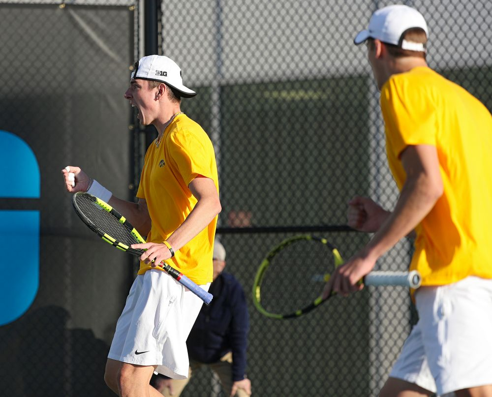 Iowa's Nikita Snezhko (from left) pounds his chest as he celebrates a point with Joe Tyler during their doubles match again Michigan State at the Hawkeye Tennis and Recreation Complex in Iowa City on Friday, Apr. 19, 2019. (Stephen Mally/hawkeyesports.com)