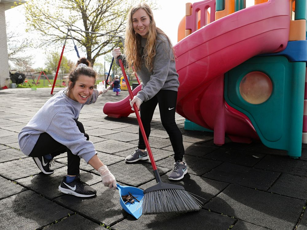 Iowa women's gymnasts clean outside Handicare during the 21st annual ISAAC Hawkeye Day of Caring in Coralville on Sunday, Apr. 28, 2019. (Stephen Mally/hawkeyesports.com)