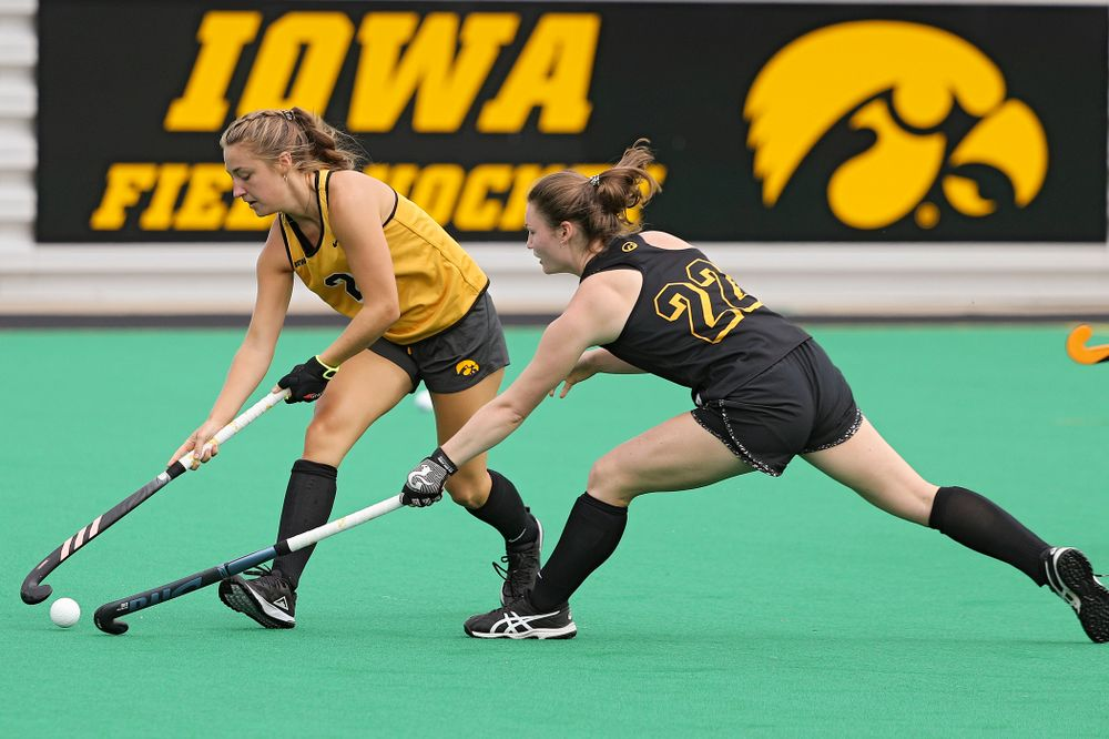 Iowa's Emily Deuell (2) and Ellie Flynn (22) run a drill during practice at Grant Field in Iowa City on Thursday, Aug 15, 2019. (Stephen Mally/hawkeyesports.com)