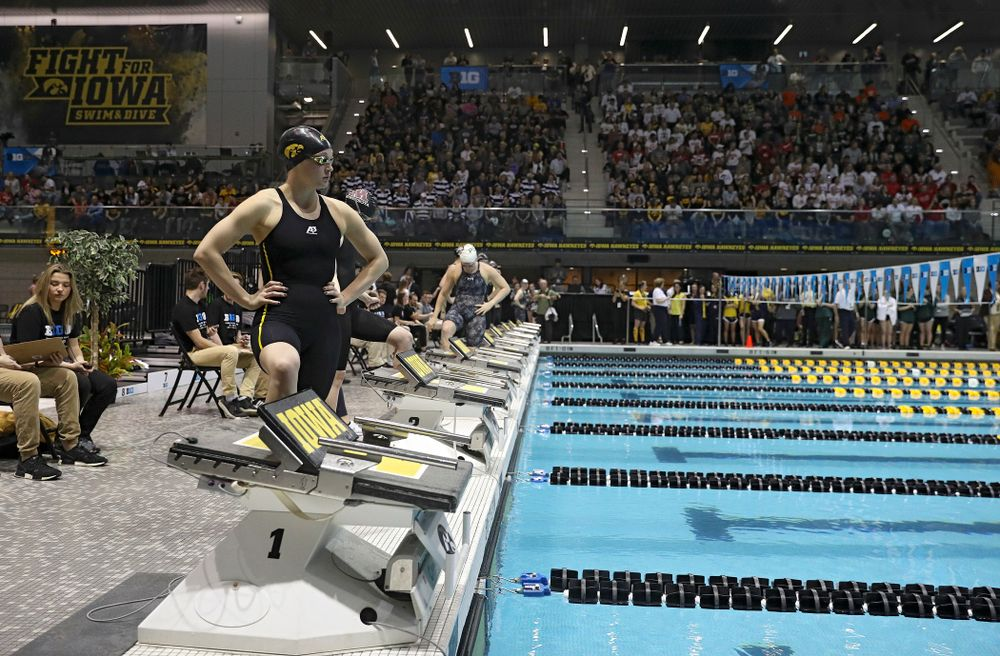 Iowa's Grace Reeder waits to swim the women's 400 yard individual medley C final event during the 2020 Women's Big Ten Swimming and Diving Championships at the Campus Recreation and Wellness Center in Iowa City on Friday, February 21, 2020. (Stephen Mally/hawkeyesports.com)
