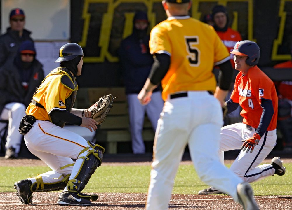 Iowa Hawkeyes catcher Austin Martin (34) tags out the runner at the plate to complete an inning ending double play during the eighth inning against Illinois at Duane Banks Field in Iowa City on Sunday, Mar. 31, 2019. (Stephen Mally/hawkeyesports.com)
