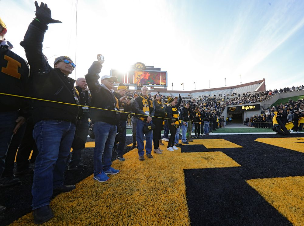 University of Iowa letterwinners form a tunnel for the senior football players before their game at Kinnick Stadium in Iowa City on Saturday, Nov 23, 2019. (Stephen Mally/hawkeyesports.com)