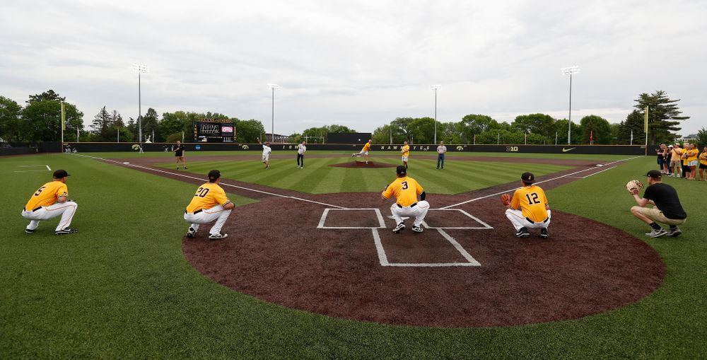 The fathers of the seniors throw out a first pitch during senior day activities before their game against the Penn State Nittany Lions Saturday, May 19, 2018 at Duane Banks Field. (Brian Ray/hawkeyesports.com)