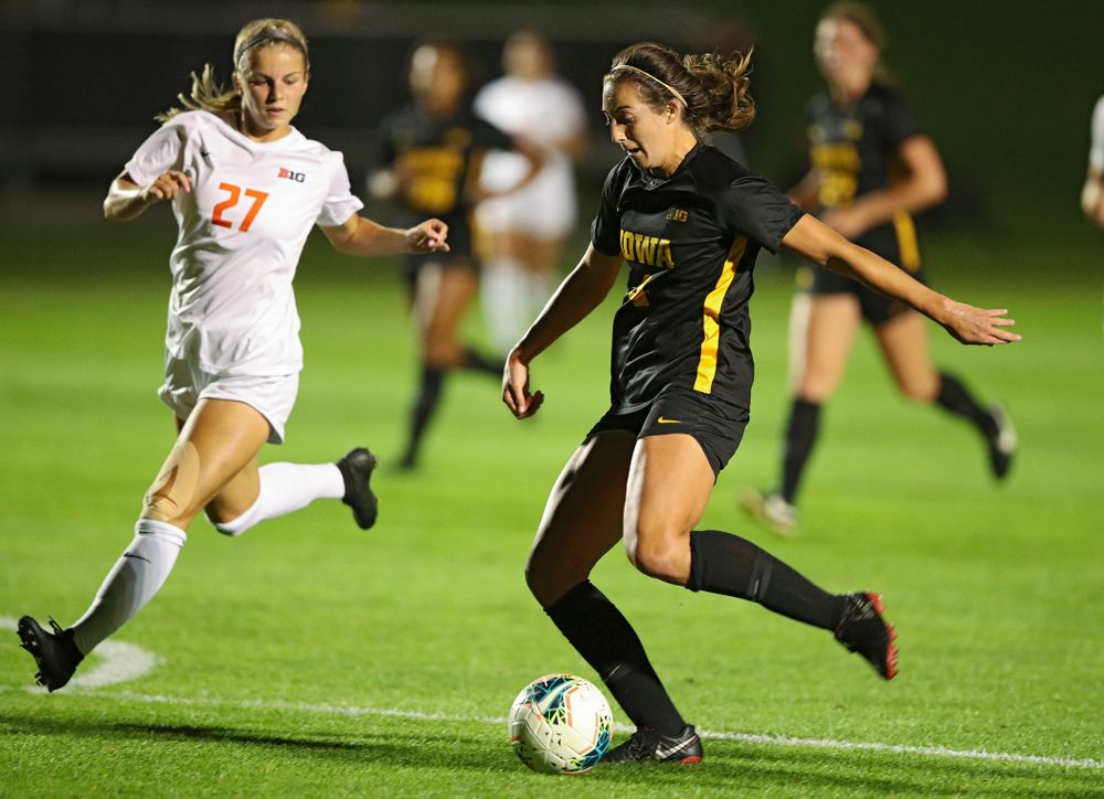 Iowa forward Kaleigh Haus (4) lines up a shot during the first half of their match against Illinois at the Iowa Soccer Complex in Iowa City on Thursday, Sep 26, 2019. (Stephen Mally/hawkeyesports.com)