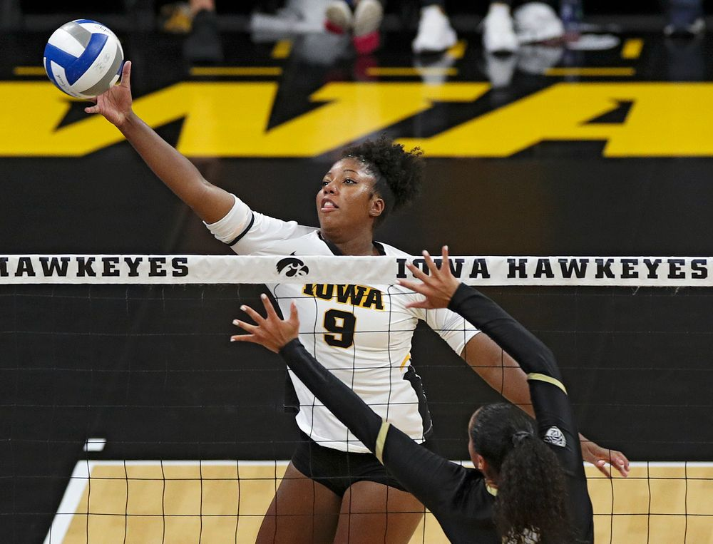 Iowa's Amiya Jones (9) tips the ball over the net during the second set of their Big Ten/Pac-12 Challenge match against Colorado at Carver-Hawkeye Arena in Iowa City on Friday, Sep 6, 2019. (Stephen Mally/hawkeyesports.com)