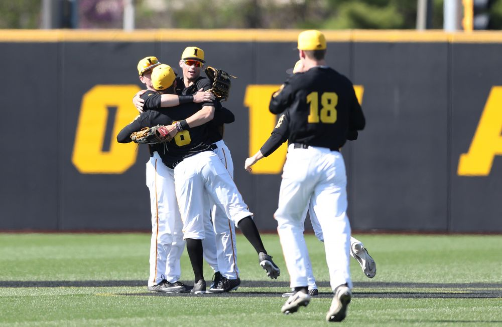 Iowa Hawkeyes Chris Whelan (28), outfielder Ben Norman (9), and outfielder Justin Jenkins (6) hug after winning game two against UC Irvine Saturday, May 4, 2019 at Duane Banks Field. (Brian Ray/hawkeyesports.com)