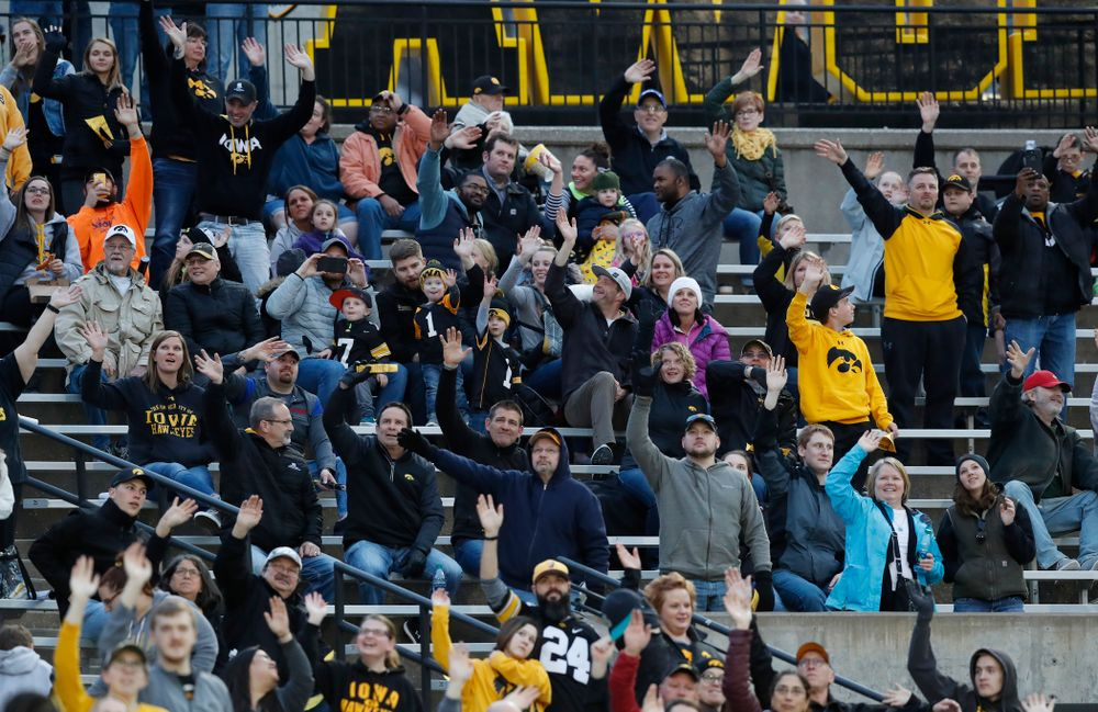 Fans wave to patients in the Stead Family Children's Hospital during Iowa Football's final spring practice Friday, April 20, 2018 at Kinnick Stadium. (Brian Ray/hawkeyesports.com)