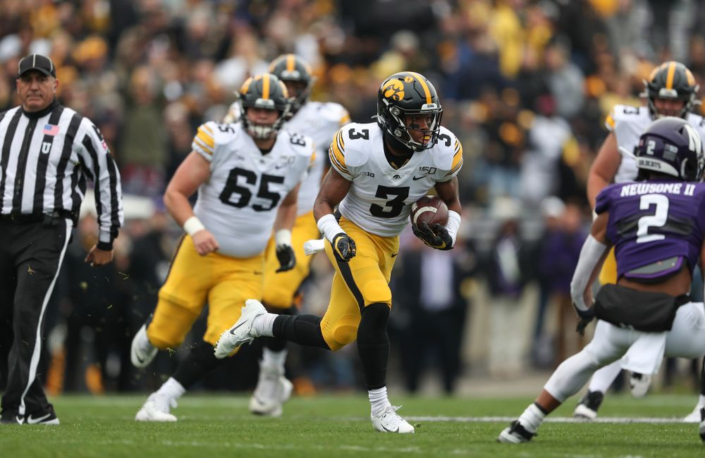 Iowa Hawkeyes wide receiver Tyrone Tracy Jr. (3) carries the ball on his way to a touchdown against the Northwestern Wildcats Saturday, October 26, 2019 at Ryan Field in Evanston, Ill. (Brian Ray/hawkeyesports.com)