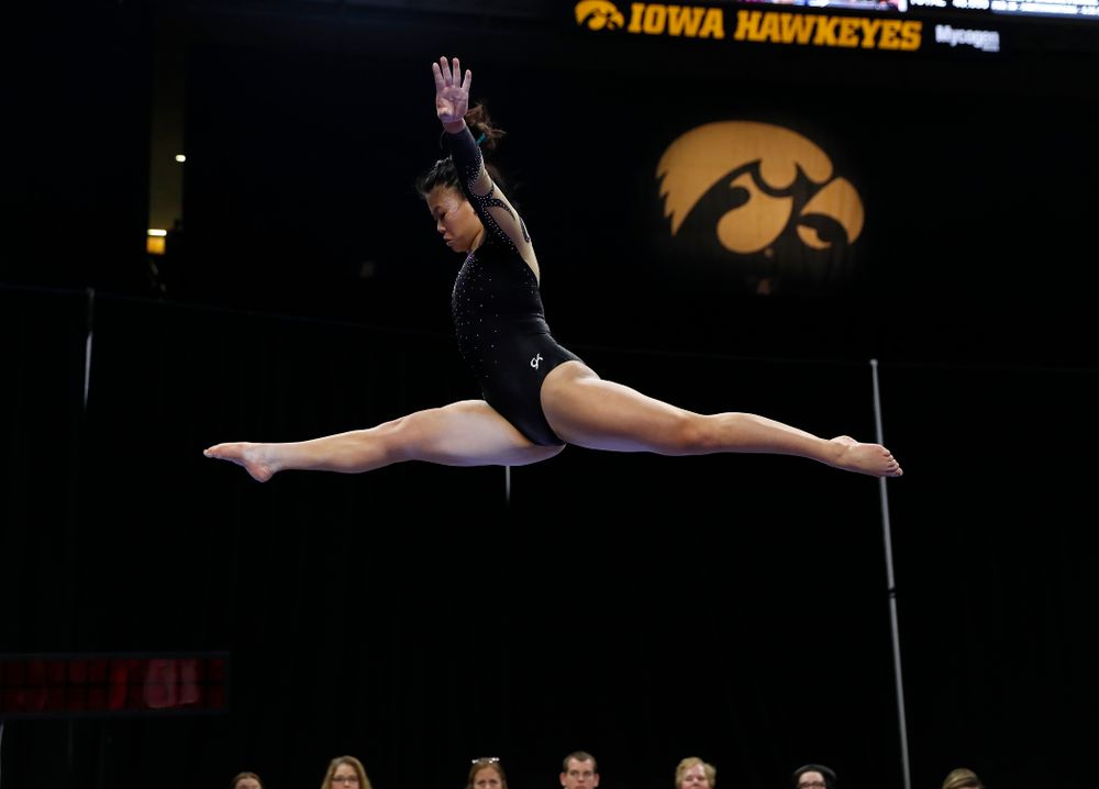 Iowa's Misty-Jade Carlson competes on the beam