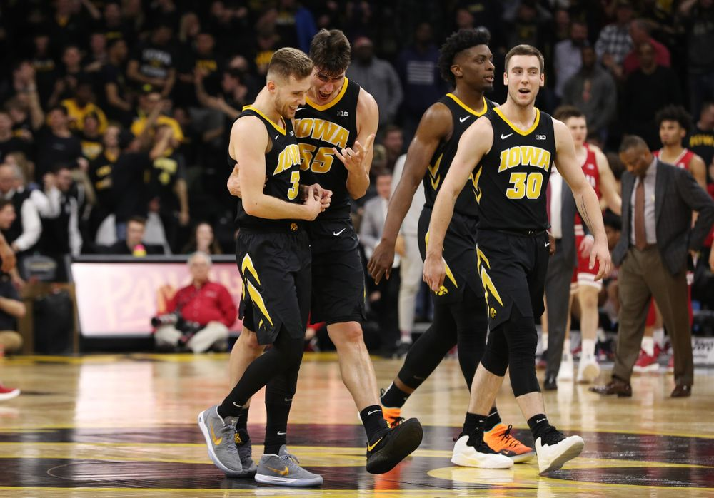 Iowa Hawkeyes guard Jordan Bohannon (3) celebrates with forward Luka Garza (55) after making a three point basket in overtime against the Indiana Hoosiers Friday, February 22, 2019 at Carver-Hawkeye Arena. (Brian Ray/hawkeyesports.com)