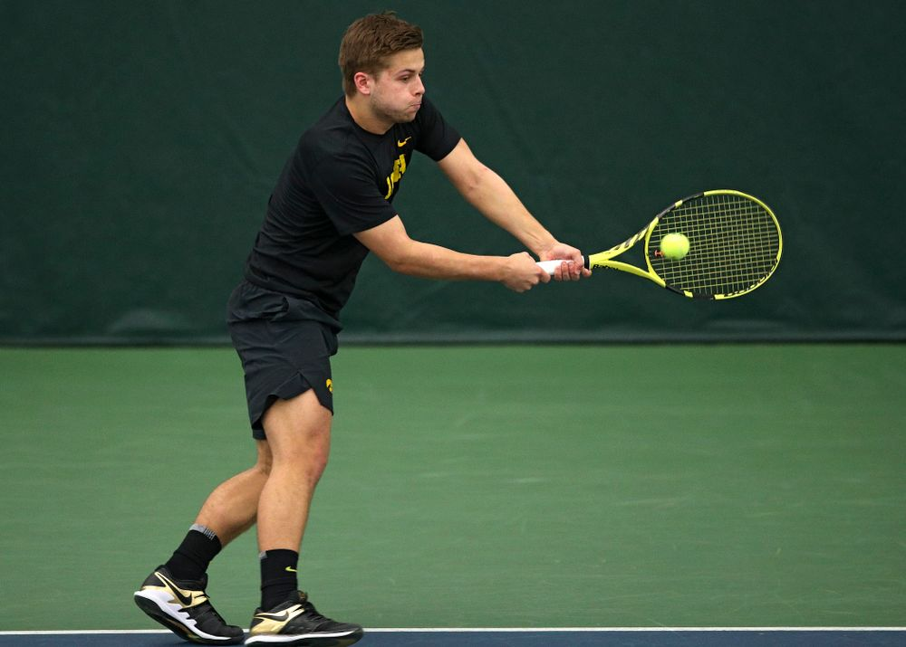 Iowa's Will Davies returns a shot during his doubles match at the Hawkeye Tennis and Recreation Complex in Iowa City on Friday, March 6, 2020. (Stephen Mally/hawkeyesports.com)
