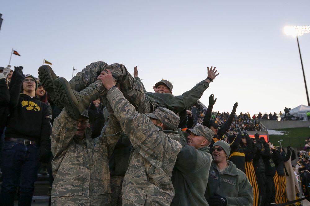 U.S. Service Members participate in the Pancheros Burrito Lift during Iowa football vs Minnesota on Saturday, November 16, 2019 at Kinnick Stadium. (Lily Smith/hawkeyesports.com)
