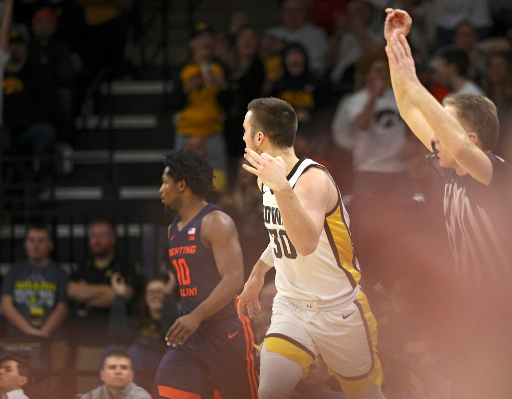 Iowa Hawkeyes guard Connor McCaffery (30) celebrates after making a 3-pointer during the second half of the game at Carver-Hawkeye Arena in Iowa City on Sunday, February 2, 2020. (Stephen Mally/hawkeyesports.com)