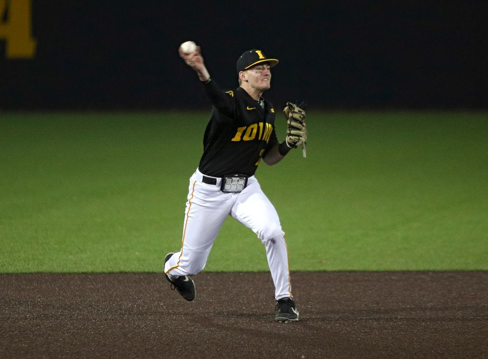 Iowa infielder Brendan Sher (2) throws to first for an out during the seventh inning of their game at Duane Banks Field in Iowa City on Tuesday, March 3, 2020. (Stephen Mally/hawkeyesports.com)