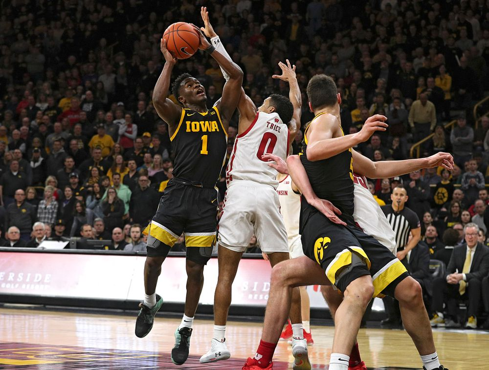 Iowa Hawkeyes guard Joe Toussaint (1) makes a basket while being fouled during the second half of their game at Carver-Hawkeye Arena in Iowa City on Monday, January 27, 2020. (Stephen Mally/hawkeyesports.com)