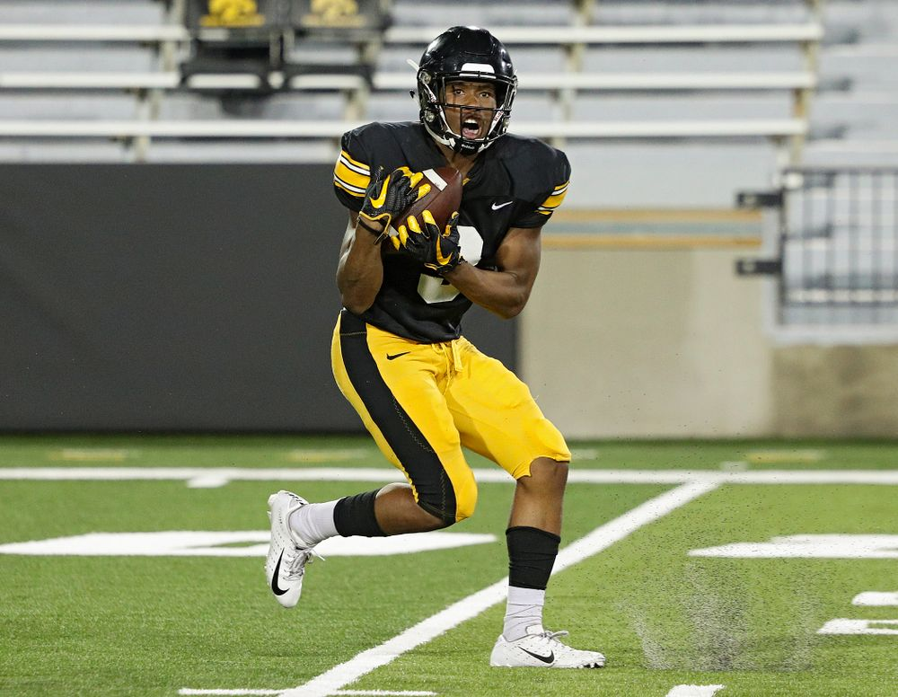 Iowa Hawkeyes wide receiver Tyrone Tracy Jr. (3) pulls in a touchdown pass during Fall Camp Practice No. 12 at Kinnick Stadium in Iowa City on Thursday, Aug 15, 2019. (Stephen Mally/hawkeyesports.com)
