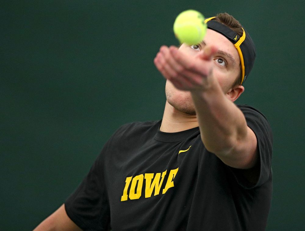 Iowa's Joe Tyler serves during their match at the Hawkeye Tennis and Recreation Complex in Iowa City on Thursday, January 16, 2020. (Stephen Mally/hawkeyesports.com)