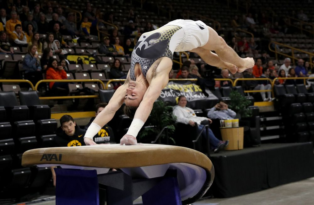 Iowa's Mitch Mandozzi competes on the vault against Illinois Sunday, March 1, 2020 at Carver-Hawkeye Arena. (Brian Ray/hawkeyesports.com)