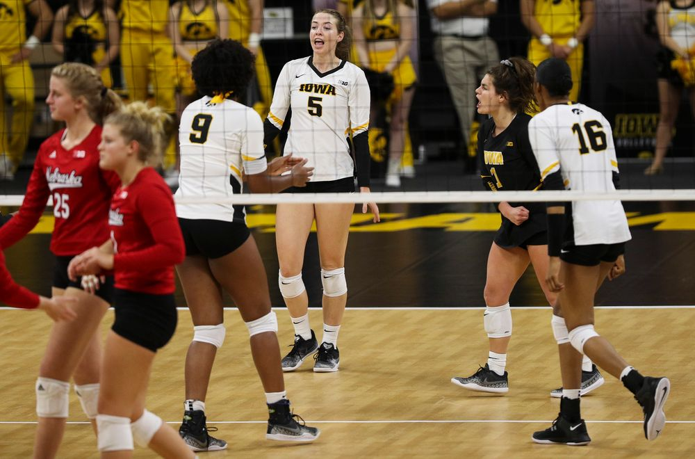Iowa Hawkeyes outside hitter Meghan Buzzerio (5) and Iowa Hawkeyes defensive specialist Molly Kelly (1) celebrate after winning a point during a match against Nebraska at Carver-Hawkeye Arena on November 7, 2018. (Tork Mason/hawkeyesports.com)