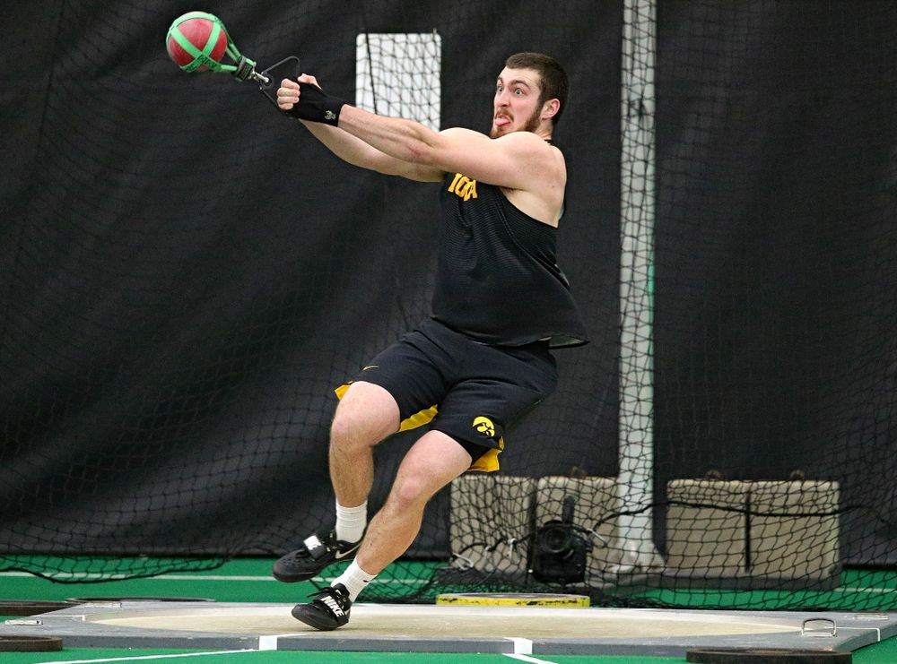 Iowa's Tyler Lienau throws in the men's weight throw event during the Hawkeye Invitational at the Hawkeye Tennis and Recreation Complex in Iowa City on Friday, January 10, 2020. (Stephen Mally/hawkeyesports.com)