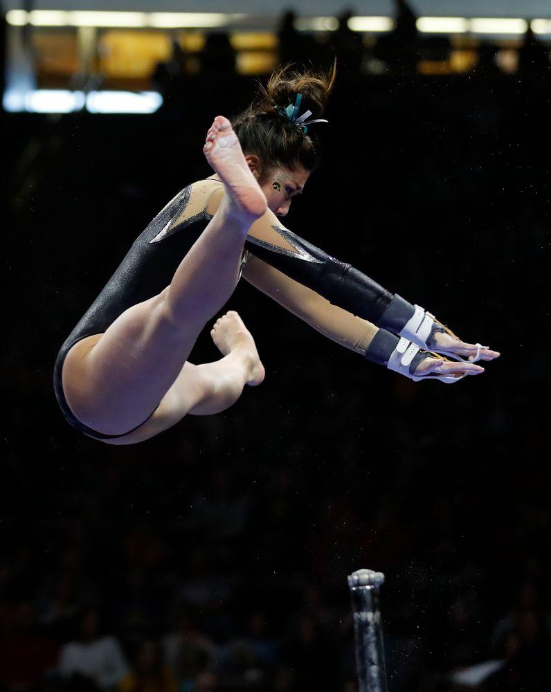 Iowa's Nicole Chow competes on the bars against the Nebraska Cornhuskers