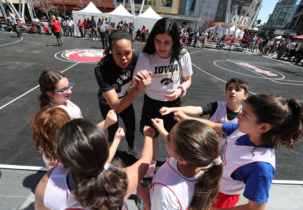 Iowa Hawkeyes forward Megan Gustafson (10) and UCONNÕs Napheesa Collier coach a team during a youth clinic and game Friday, April 12, 2019 in the XBOX Plaza at LA Live.  (Brian Ray/hawkeyesports.com)