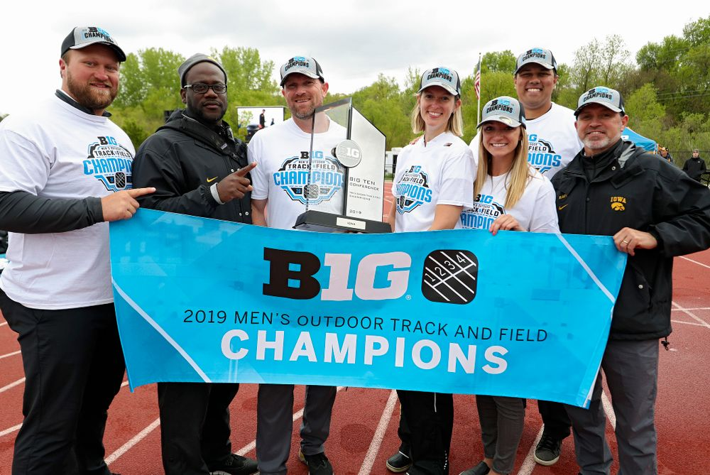 Iowa assistant coach Eric Werskey (from left), assistant coach Clive Roberts, Director of Track and Field Joey Woody, director of operations Kate Wakenight, assistant coach Paige Knodle, assistant coach Jason Wakenight, and associate head coach Randy Hasenbank after winning the Men's Big Ten Outdoor Track and Field Championships on the third day of the Big Ten Outdoor Track and Field Championships at Francis X. Cretzmeyer Track in Iowa City on Sunday, May. 12, 2019. (Stephen Mally/hawkeyesports.com)