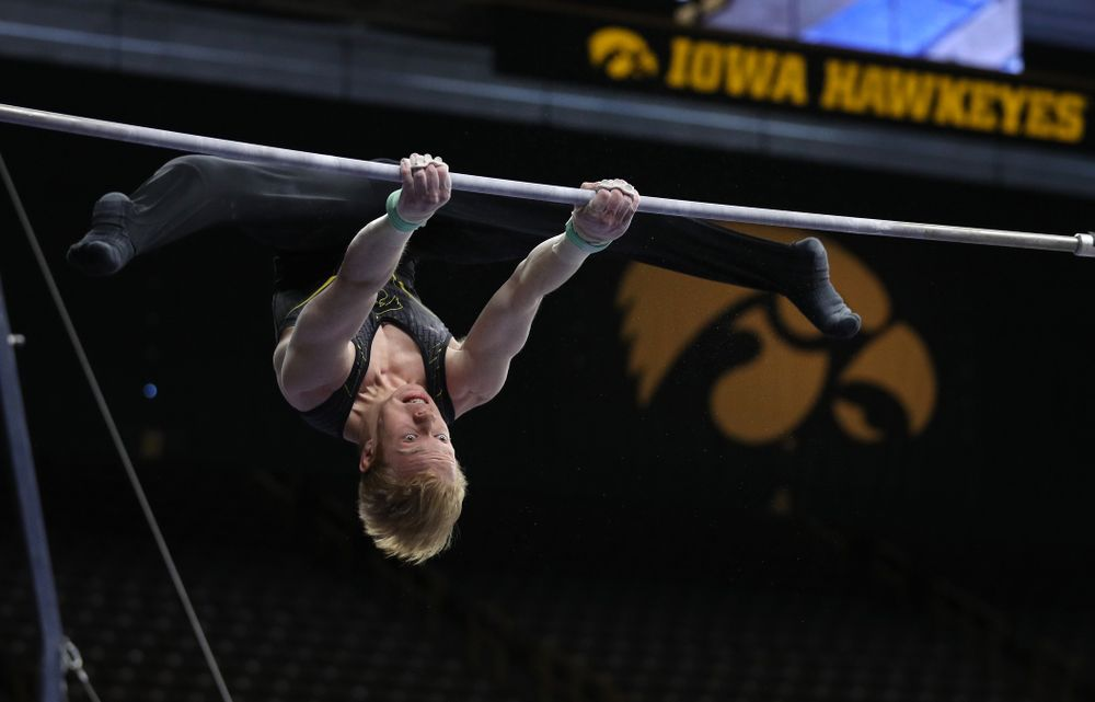 Iowa's Nick Merryman competes on the high bar against the Ohio State Buckeyes Saturday, March 16, 2019 at Carver-Hawkeye Arena.  (Brian Ray/hawkeyesports.com)