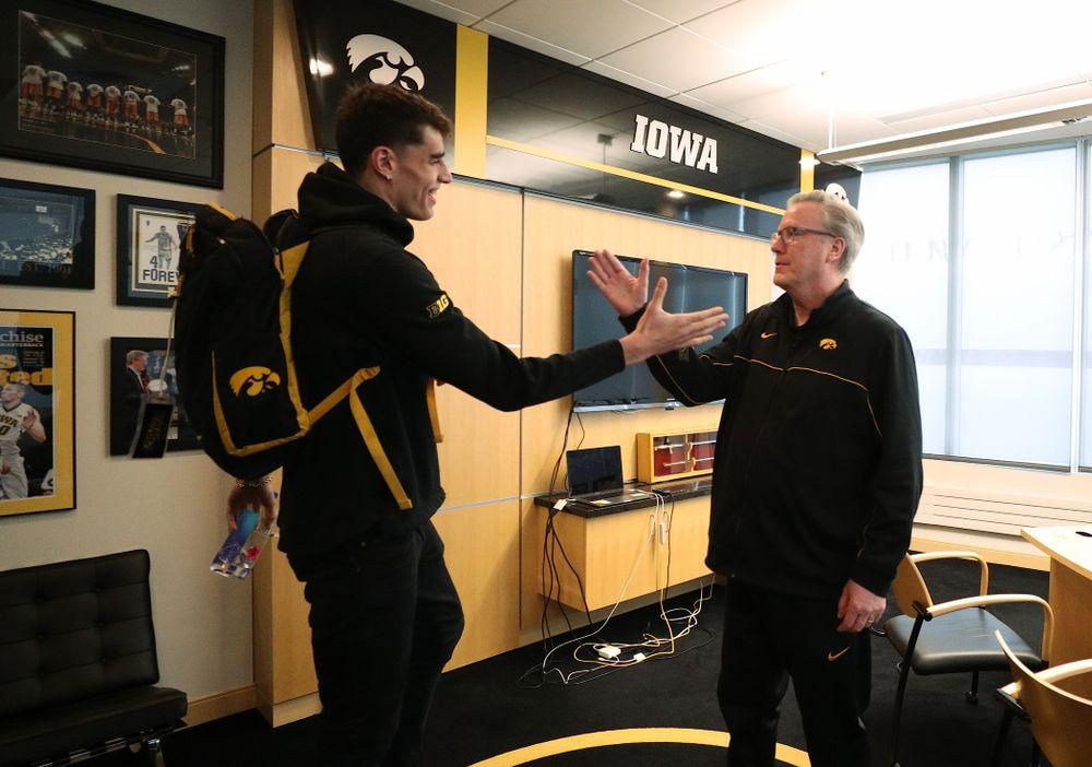 Iowa Hawkeyes head coach Fran McCaffery tells forward Luka Garza (55) that he has been named the Big Ten Player of the Year Monday, March 9, 2020 at Carver-Hawkeye Arena. (Brian Ray/hawkeyesports.com)