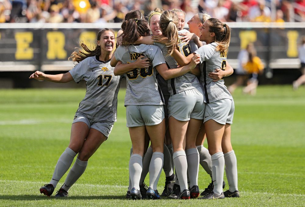 The Hawkeyes celebrate after forward Kaleigh Haus (4) scored a goal during the first half of their match at the Iowa Soccer Complex in Iowa City on Sunday, Sep 1, 2019. (Stephen Mally/hawkeyesports.com)