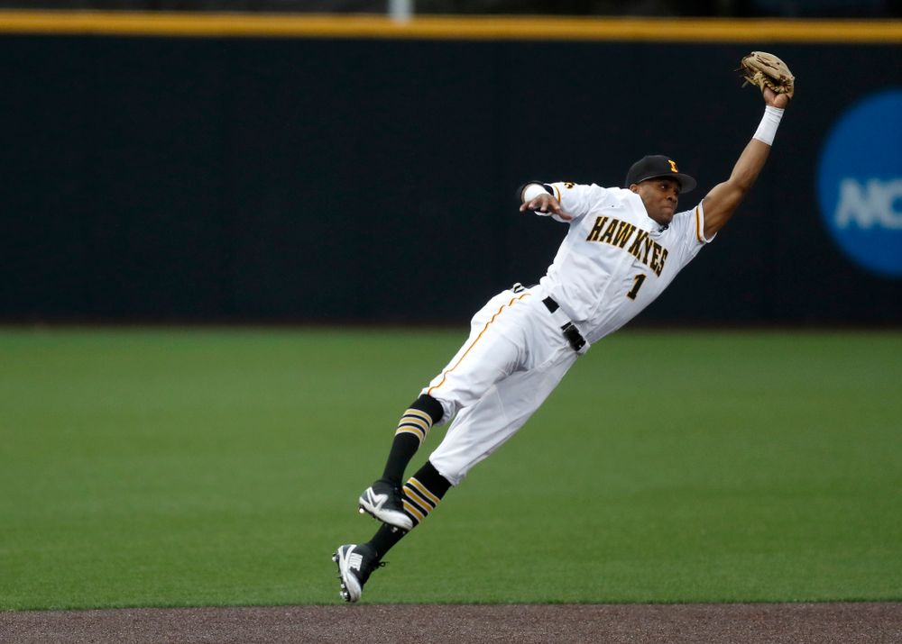 Iowa Hawkeyes third baseman Lorenzo Elion (1) makes a leaping catch on a line drive against Coe College Wednesday, April 11, 2018 at Duane Banks Field. (Brian Ray/hawkeyesports.com)