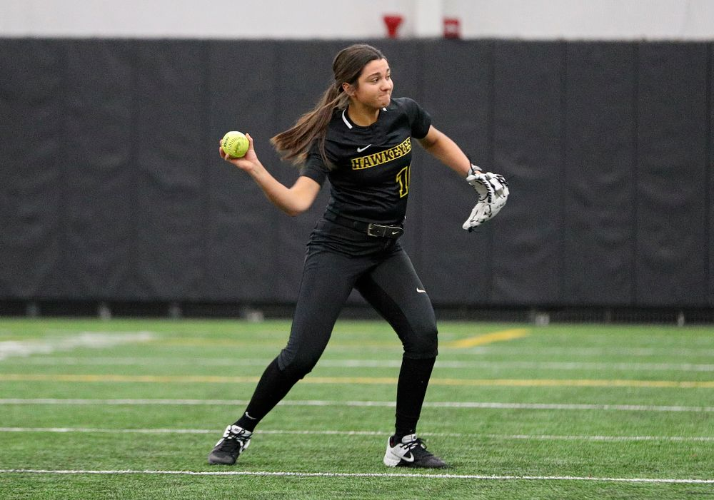 Iowa infielder Nicole Yoder (10) throws to first as they run a drill during Iowa Softball Media Day at the Hawkeye Tennis and Recreation Complex in Iowa City on Thursday, January 30, 2020. (Stephen Mally/hawkeyesports.com)