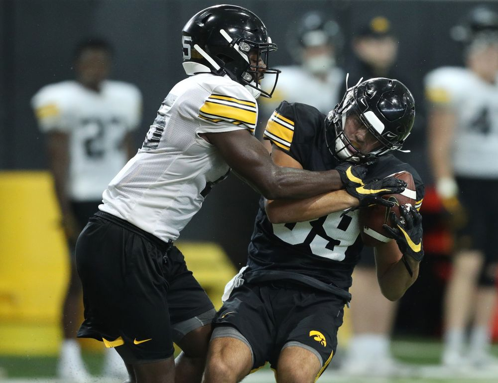 Iowa Hawkeyes defensive back Dallas Craddieth (15) and wide receiver Nico Ragaini (89) during Fall Camp Practice No. 16 Tuesday, August 20, 2019 at the Ronald D. and Margaret L. Kenyon Football Practice Facility. (Brian Ray/hawkeyesports.com)