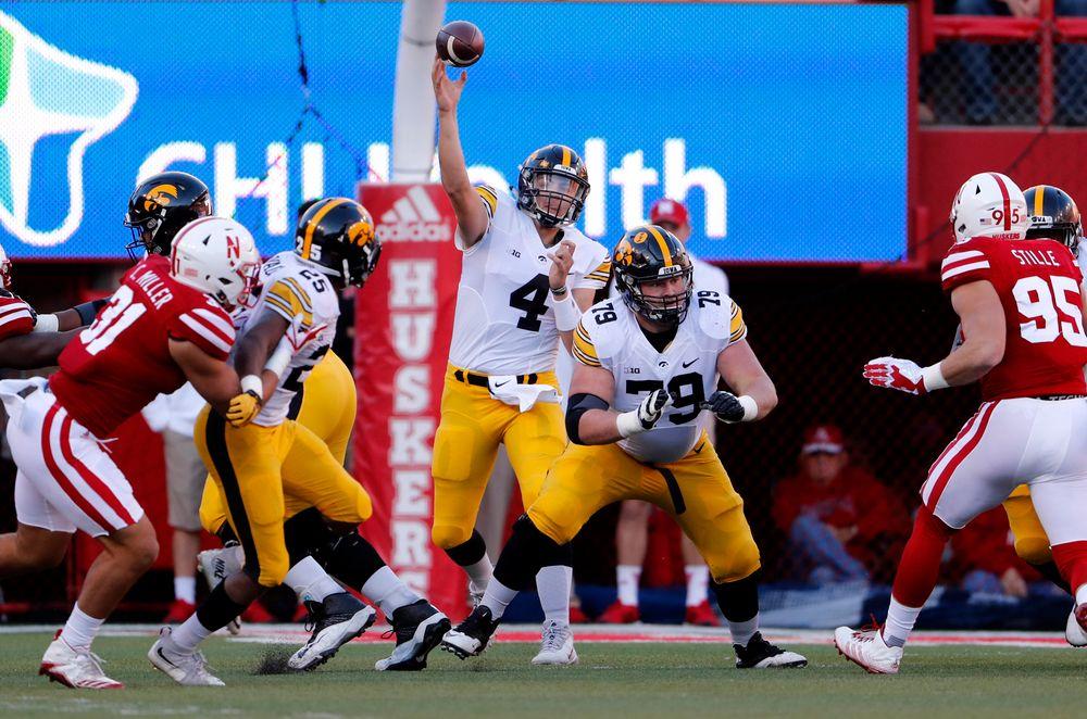 Iowa Hawkeyes quarterback Nathan Stanley (4) and offensive lineman Sean Welsh (79)